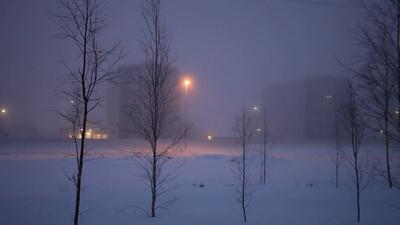 Traffic on a foggy winter evening
