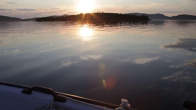 Traveling in a small boat on a bay while the sun is settin