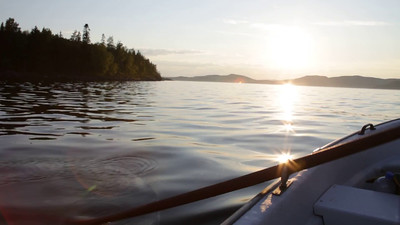 Rowing a boat on a fjord of the Baltic Sea