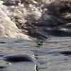 Waves rolling onto a rocky coast