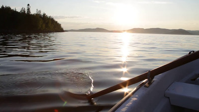 Rowing a boat on a fjord of the Baltic Sea in Sweden