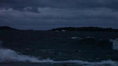 An autumn storm drives waves against the coast