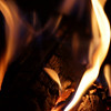 Logs burning in an open fireplace