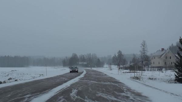Kra bil på snöig väg - Pov: driving on a wintry country road wihen snow dust is reducing visibility