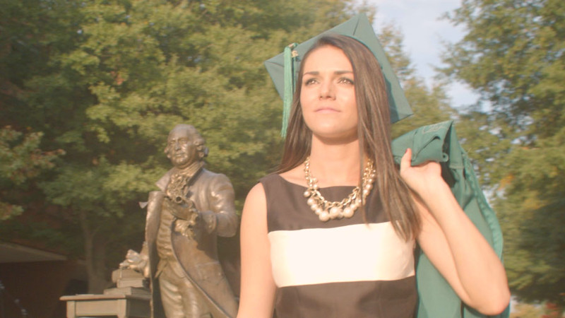 Graduate Walking by Statue B-Roll
