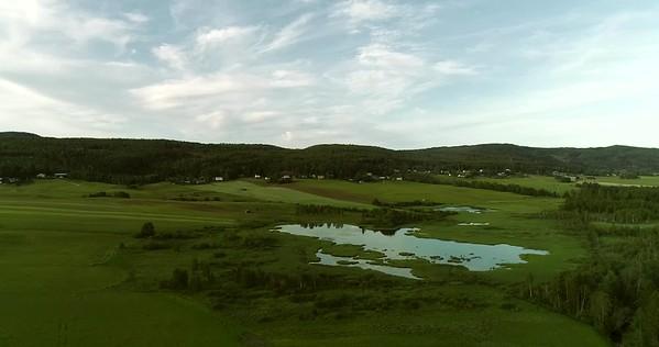 Östansjösjön och Gottne från ovan -  Aerial: rising over a lake in a wide valley with meadows and villages