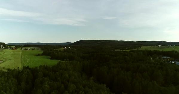 Östansjösjön och Gottne från ovan -  Aerial:360 degrees pan over a rural landscape with lake and forests