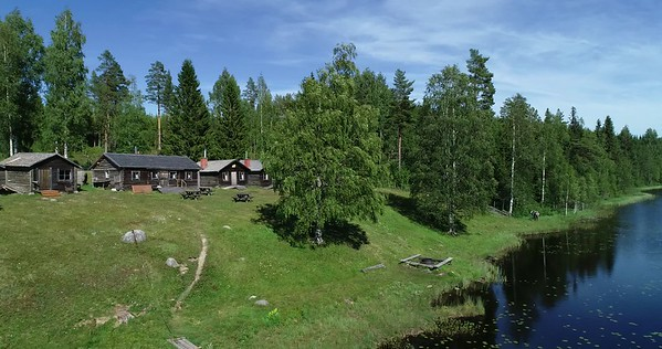 Bodsjön från ovan -  Aerial: flying past a Swedish hill farm at a forest lake