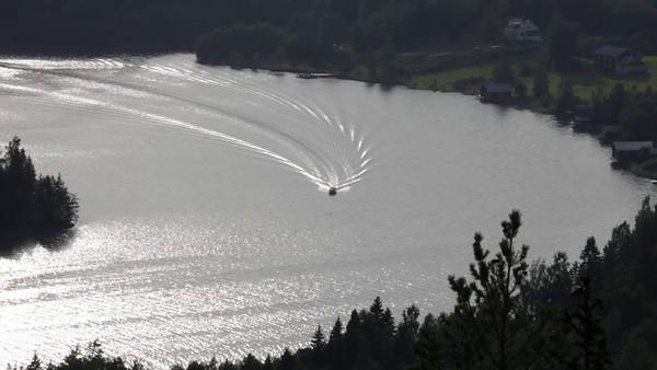 Gaviksfjärden  sett från Storberget - A motor yacht crosses a bay