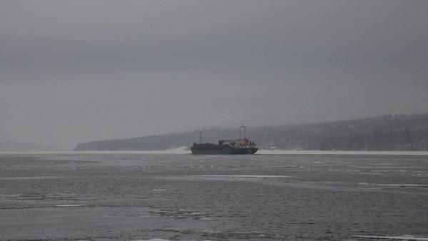 Sannasundet på vintern -  A ship moves through ice floes on a river