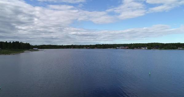 Järnäsklubb på sommaren -  Aerial: flying over a jetty with a fluttering hawk kite
