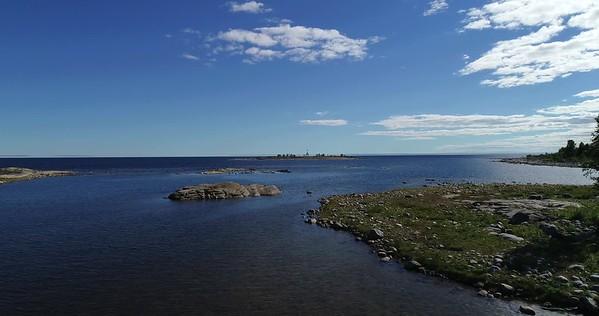 Järnäsklubb på sommaren -  Aerial: flying over an inlet towards the open sea