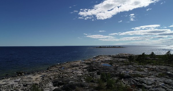 Järnäsklubb på sommaren -  Aerial: flying over the rocky coast of the Baltic Sea on a sunny summer day