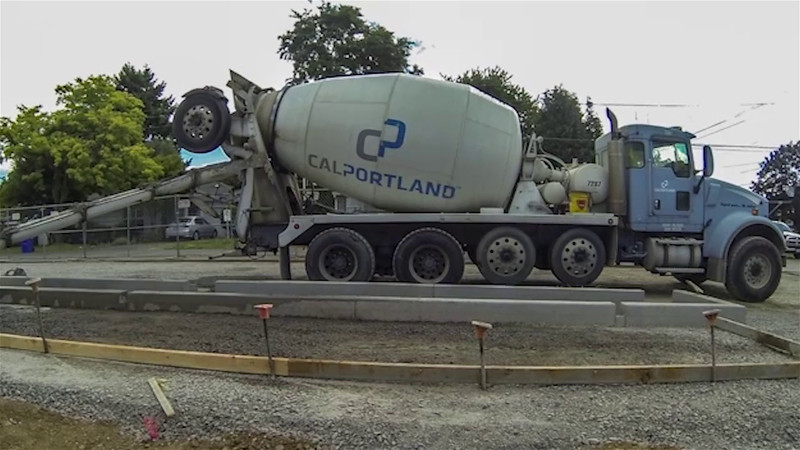 A short time lapse of a sidewalk concrete pour sequence.