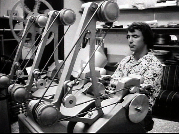 "Tom Chamberlin editing ""Land's Edge' on the Movieola at Northwestern, Inc. (:57) 1974."