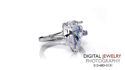 Pear Cut Baguette Diamond Ring On White_1