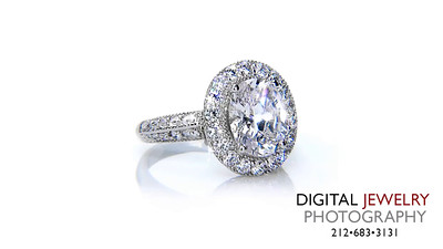 Oval Halo Diamond Ring On White_1