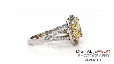 Yellow Oval Diamond Halo Ring On White_1