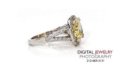 Yellow Oval Diamond Halo Ring On White_1