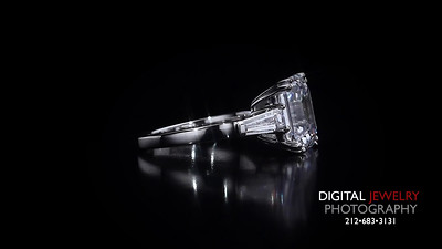 3 Stone Emerald Cut and baguettes Diamond Ring