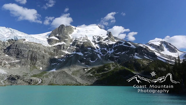 Pan across the upper Lake at Joffre Lakes Provincial Park, BC, Canada.  Stock video footage by Mitch Winton - coastphoto.com