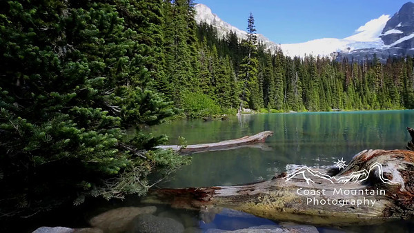 Pan across second Lake at Joffre Lakes Provincial Park, BC, Canada.  Stock video footage by Mitch Winton - coastphoto.com