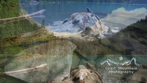 Pan up from rock to glacier from the second Lake at Joffre Lakes Provincial Park, BC, Canada.  Stock video footage by Mitch Winton - coastphoto.com