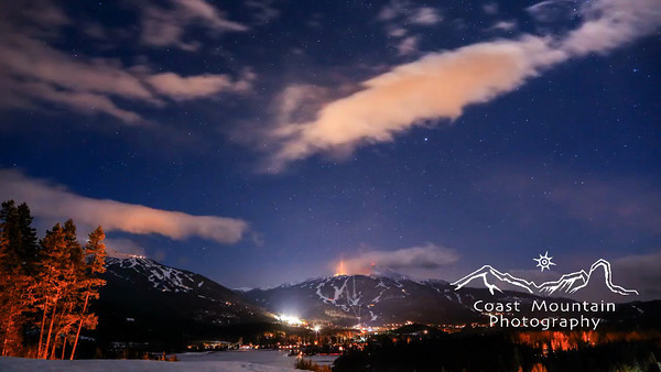 A night sky timelapse over Whistler valley including both Whistler and Blackcomb mountain covered in snow Stock video footage by Mitch Winton - coastphoto.com