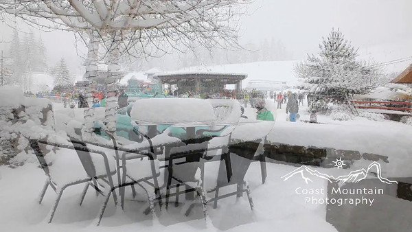 Snow covered tables with Blackcomb Gondola in the background. Shot includes a slider move Stock video footage by Mitch Winton - coastphoto.com