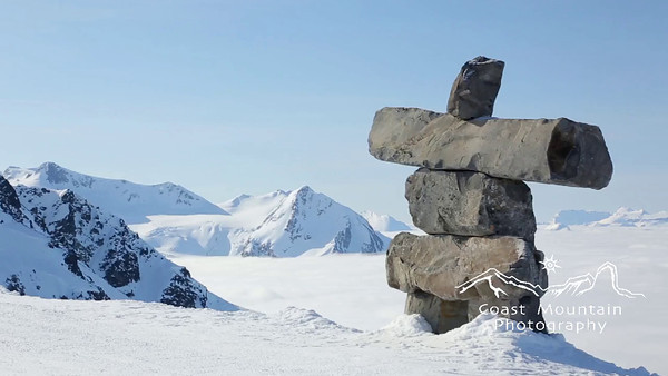 A pan past the Inukshuk at 7th Heaven above the valley cloud Stock video footage by Mitch Winton - coastphoto.com