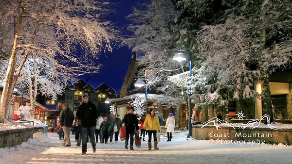 Busy, snow covered Whistler Village scene  Stock video footage by Mitch Winton - coastphoto.com