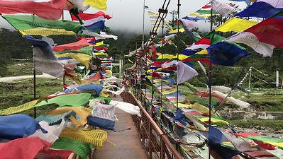 Prayer flags on bridge in Yumthang valley