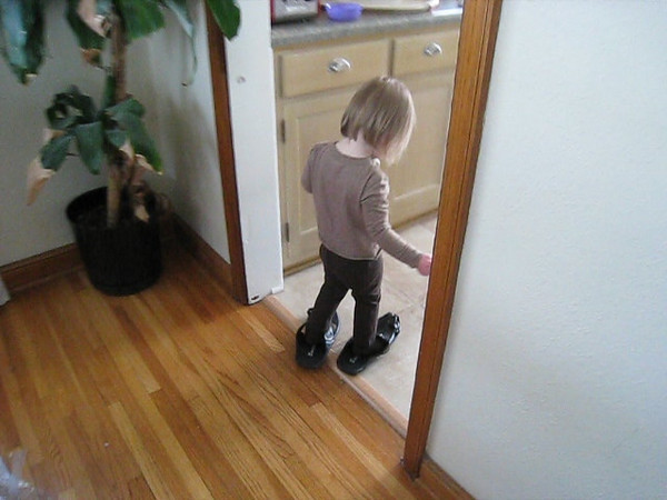 Walking around in Ben's West African sandals.  She got them out of the closet and put them on herself!  <br /> Feb 23, 2009