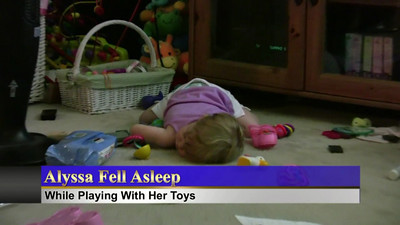 Alyssa fell asleep while playing with her toys...Only to be woken up by the Gilmore Girls song.