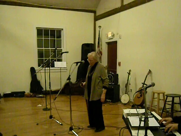 Sue's very first Acoustic Weston concert, at The Grange.  Mom performed, with stuffy sinuses and all, Soon It's Gonna Rain from The Fantasticks - #1