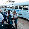 Children arrive by foot, moped, motorcycle and bus for a 7pm chapel service each morning.