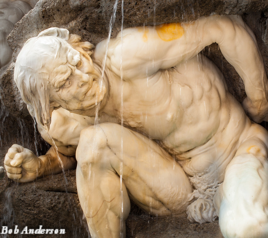 "Detail shot of one of the statues that make up the ""Power on Land"" fountain, Vienna"