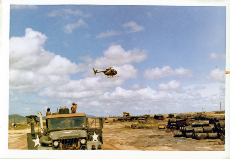 "The ""Loach"" or light observation helicopter (OH-6A ""Cayuse"") seen just outside the ""wire"" at Di An Basecamp, the home of the 11th Armored Cavalry Regiment in 1971."