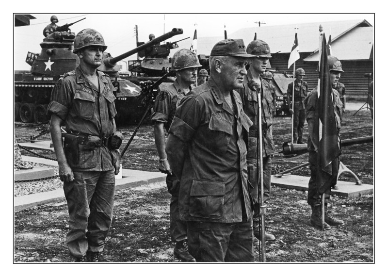 "Four-star General Creighton ""Abe"" Abrams speaks to Blackhorse Troopers outside of Regiment Headquarters at Di An.  Colonel Donn A. Starry (the highly decorated commander of the 11th Armored Cavalry Regiment who was wounded in the unit's incursion into Cambodia, and later a four-star general himself) looks on. Photo by Mike Roche 1971."