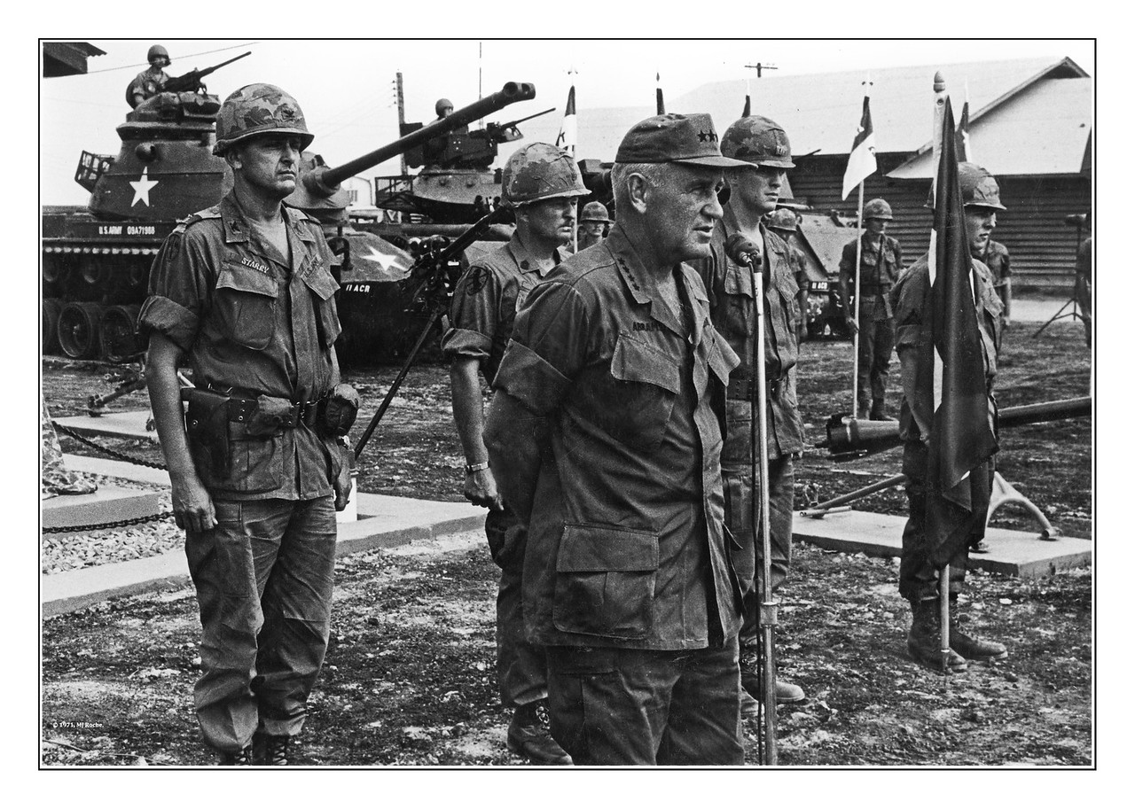 "Four-star General Creighton ""Abe"" Abrams speaks to Blackhorse Troopers outside of Regiment Headquarters at Di An.  Colonel Donn A. Starry (the highly decorated commander of the 11th Armored Cavalry Regiment who was wounded in the unit's incursion into Cambodia, and later a four-star general himself) looks on."