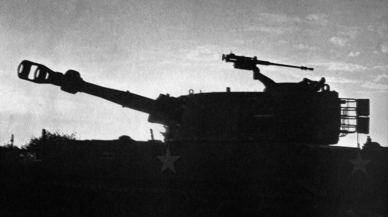 Silhouette of a 155mm Howitzer from the 3/13th Field Artillery of the 25th Infantry Division at their basecamp at Cu Chi at dusk.  Photo, 25th Inf. Div.
