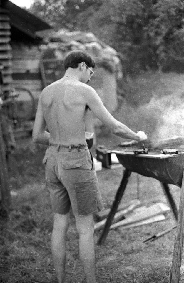 R.J. House applies seasoning on the barbie behind our hooch. You will note the sandbagged 17th PID  bunker in the background.
