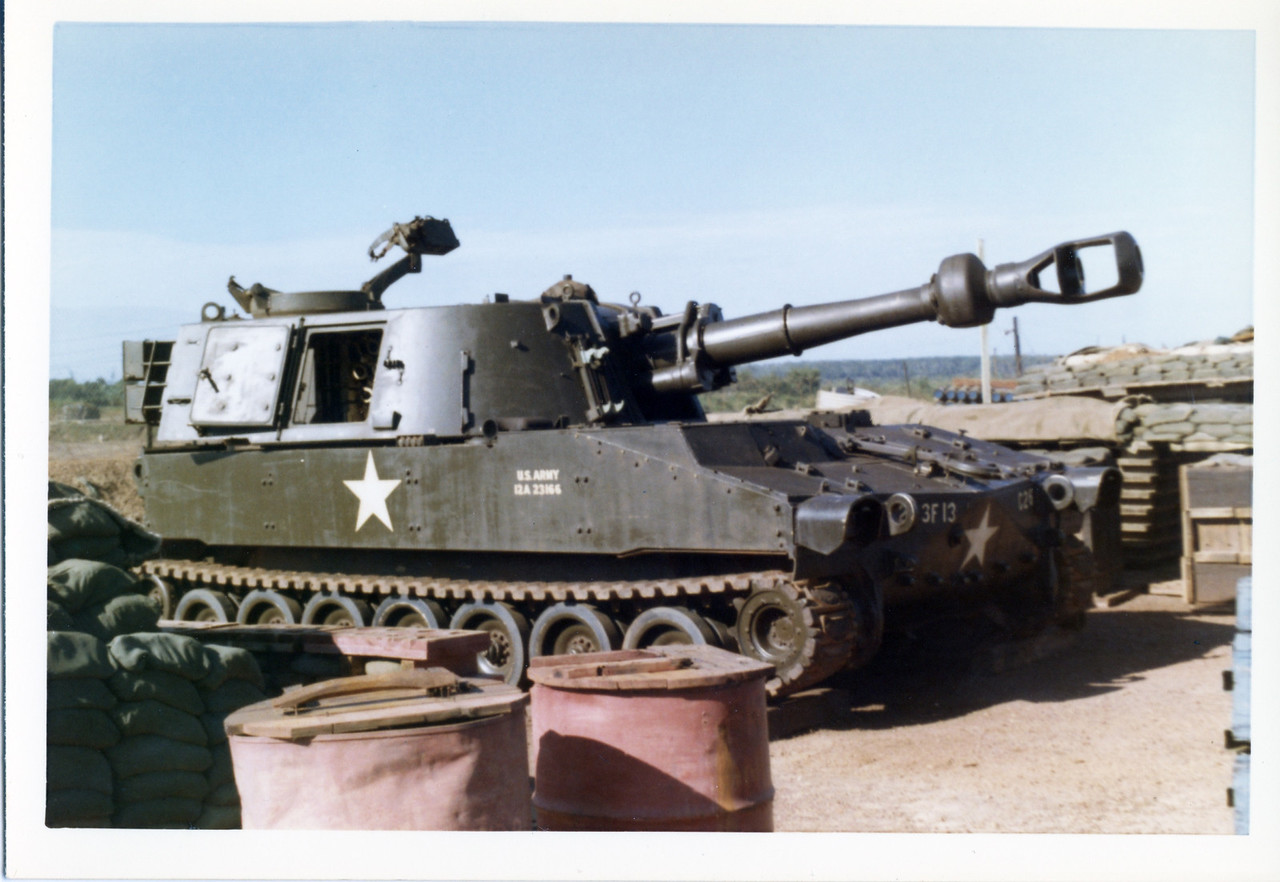 "The M109 155mm Self-Propelled Howitzer at a fire support base on the border of Cambodia.  The ""3F13"" marking on the front refers to the 3rd Battalion of the 13th Field Artillery, embedded in the 25th Infantry Division.  Taken in August 1970. Photo by MJ Roche."