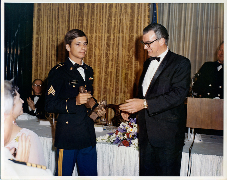 "Henry Luce III, the elder son of the founder and editor in chief of Time Inc., presents the ""Thomas Jefferson Award"" for best military offset newspaper in the world.  Accepting for the Engineer Command, Long Binh, RVN, is the editor of the""Castle Courier"" newspaper, in May, 1971, at the State Department, Washington, D.C.  Lief Ericson, actor and star of the ""High Chaparral"" TV series, served as emcee (right at podium)."