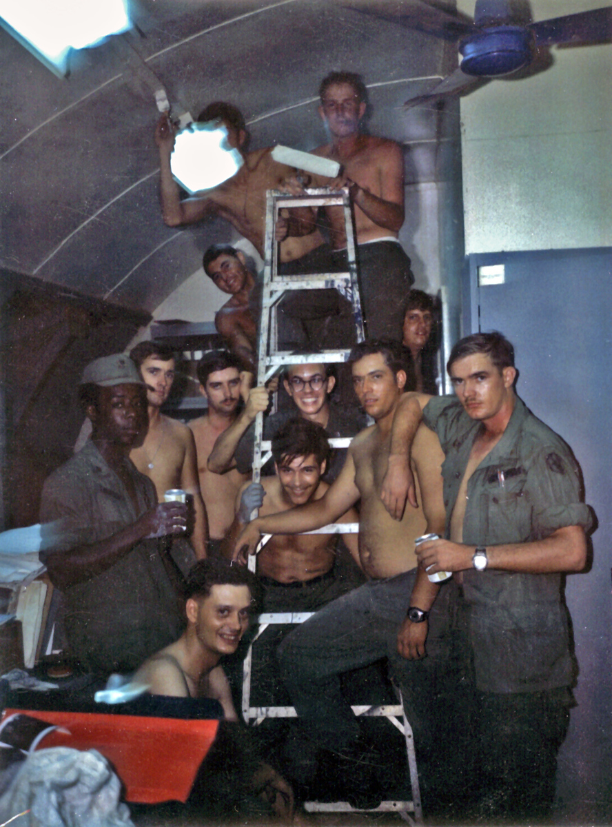 Admin Office, 3/13th Field Artillery, 25th Infantry Division, Cu Chi, RVN. Our quonset hut office during a repainting party in the evening.  Digital scan from a 45 year-old Polaroid print. October 1970.
