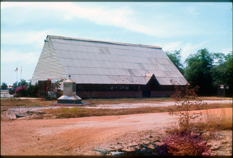 The 11th ACR  Chapel at Di An circa February 1971.   The marker in front holds brass plates with the names of fallen troopers, many recently added from the incursion into Cambodia in mid 1970.  © 1971, MJ Roche.