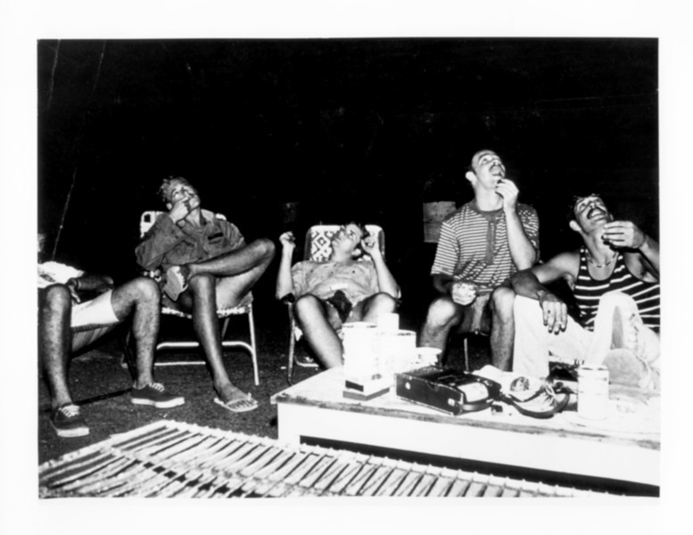 "At the nightly ""circle of lawn chairs""  between the hooches at Long Binh.  Listening to tapes, barbequing a steak, drinking a beer, and watching aircraft overhead.  A buddy from Maryland taught me how to enjoy a fine French Pinot Noir at this site.  © 1971, MJ Roche."