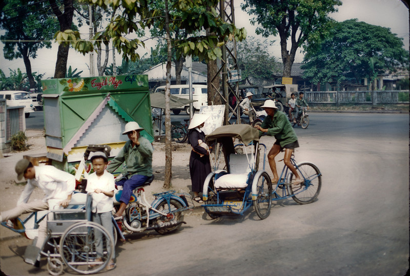 Cyclo drivers and Roman Catholic nun, Saigon streets, winter, 1971.  © 1971, MJ Roche.