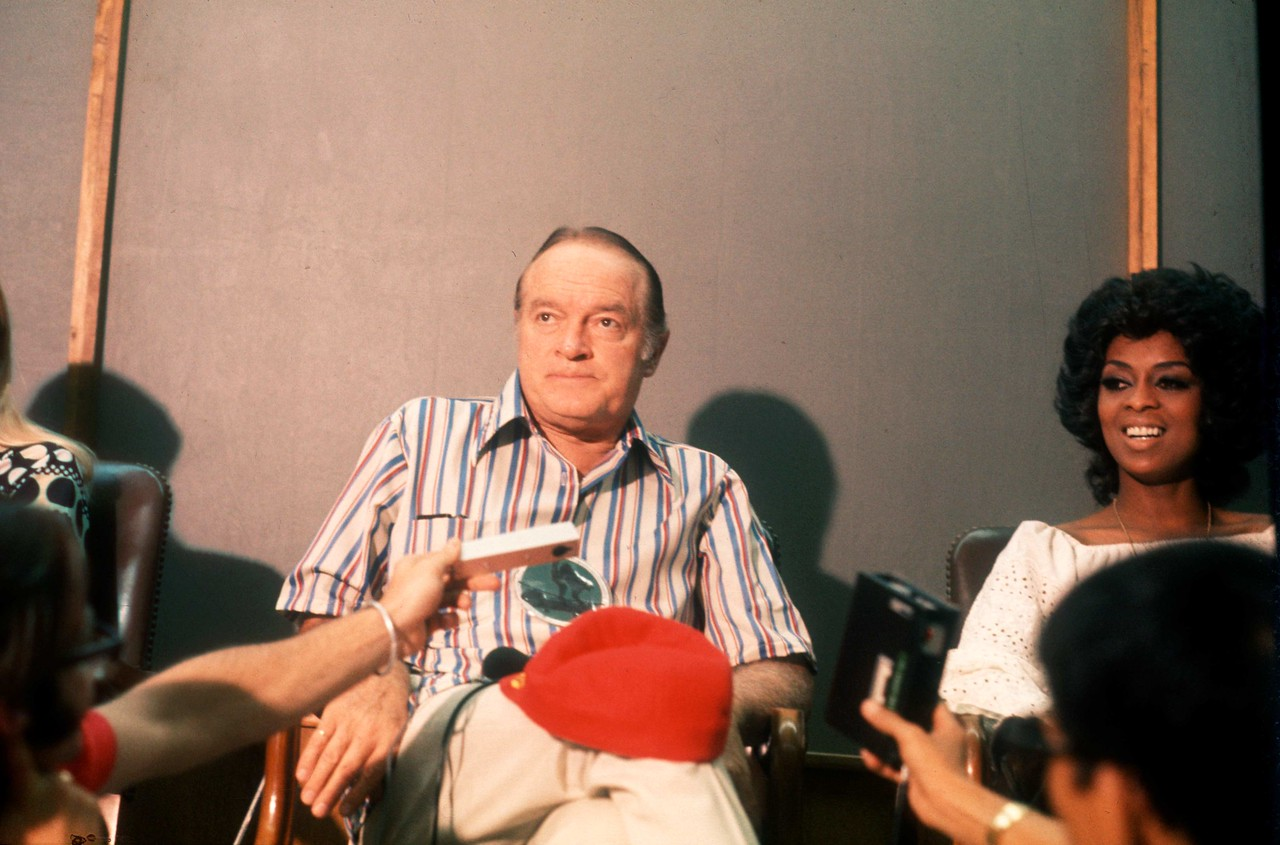 Bob poses next to  Lola Falana at the press conference following the Christmas Day Show at Long Binh.