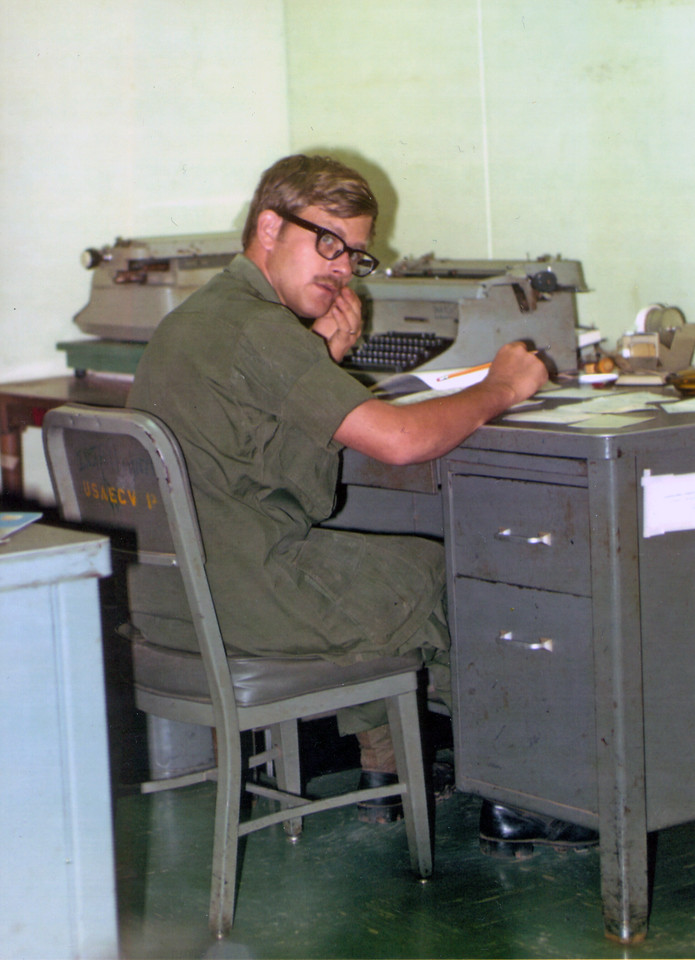 Castle Courier Assistant Editor Bill Smith at the Head Shed (US Army Headquarters, Vietnam).